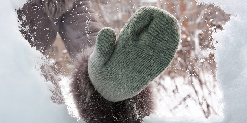 Snowy mitten on window